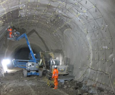 Installation of distributed fiber optic sensors on sprayed concrete lining tunnels